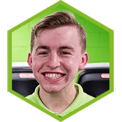 headshot of trainer Alex with green border